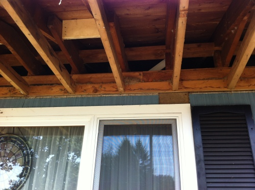 Under eave of roof
