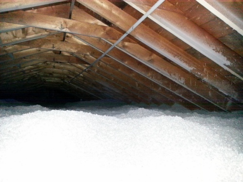 This is what the attic looks like now.  Nothing to see.  The conduit on the rafters was installed by Nik before the attic got insulated.  He's planning for future solar on our east-facing roof and wanted to be able to get the wiring back to the inverters without having to wade through the cellulose.