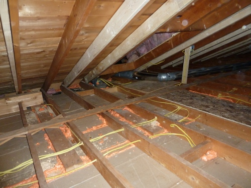 Making the inside of the house a different temperature from outdoors creates a pressure difference between inside and out.  The pressure causes air to move through holes and cracks of any size.  Even a hairline crack can leak all season long.  Uncontrolled leakage is the biggest cause of heat loss.  To save energy and keep the house comfortable, seal all holes and cracks, no matter how small.  Here one-part spray foam seals the crack between the ceiling drywall and the top plates of the partition walls.