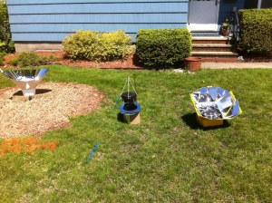 Here are three of my solar cookers in side-by-side tests.  I have to orient them to the sun every hour or so.