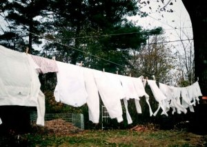 Drying laundry outside takes more time, can't be done any ol' day, and leaves heavy clothes a little dampish.